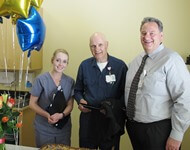 Salida hospital CEO Bob Morasko congratulates Ron Bobo, TRAC STAR of the first quarter, and finalist Kayla Jimerson at a hospital ceremony on April 25