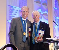 Robert Hunter, M.D., (L) at his induction as president of The Arthroscopy Association of North America with past AANA president John Richmond, M.D.